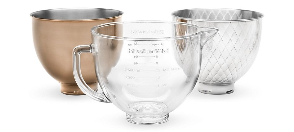 Three interchangeable stand mixer bowls in glass, quilted stainless steel and radiant copper