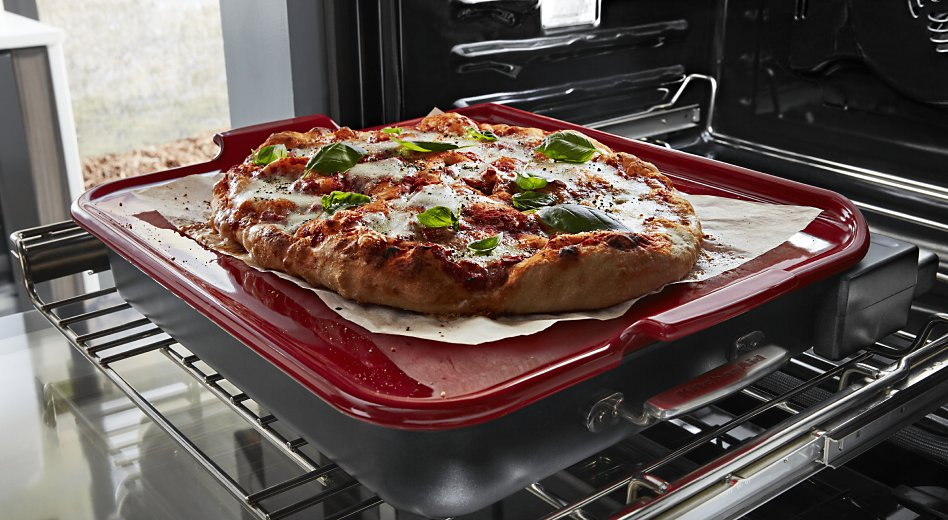 Pizza on baking stone in oven