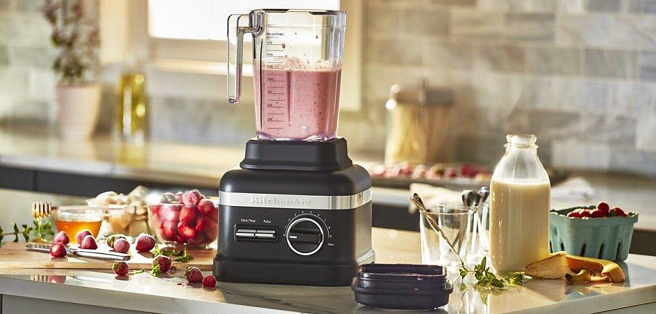 Black blender making a smoothie on counter