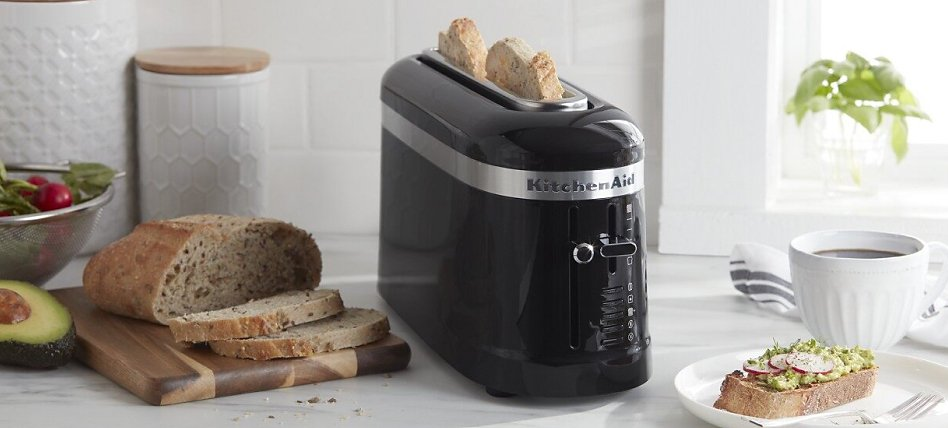 Black one-slot toaster with slices of bread