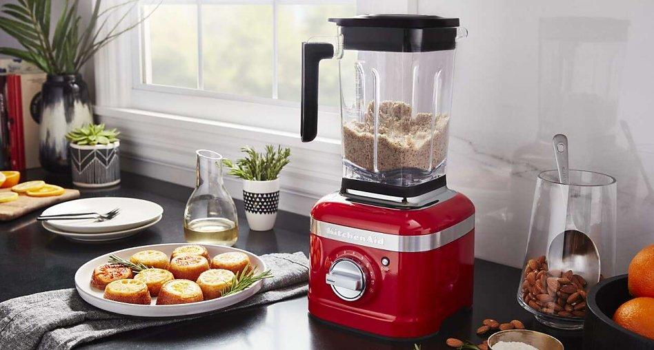 Red blender making almond flour on counter