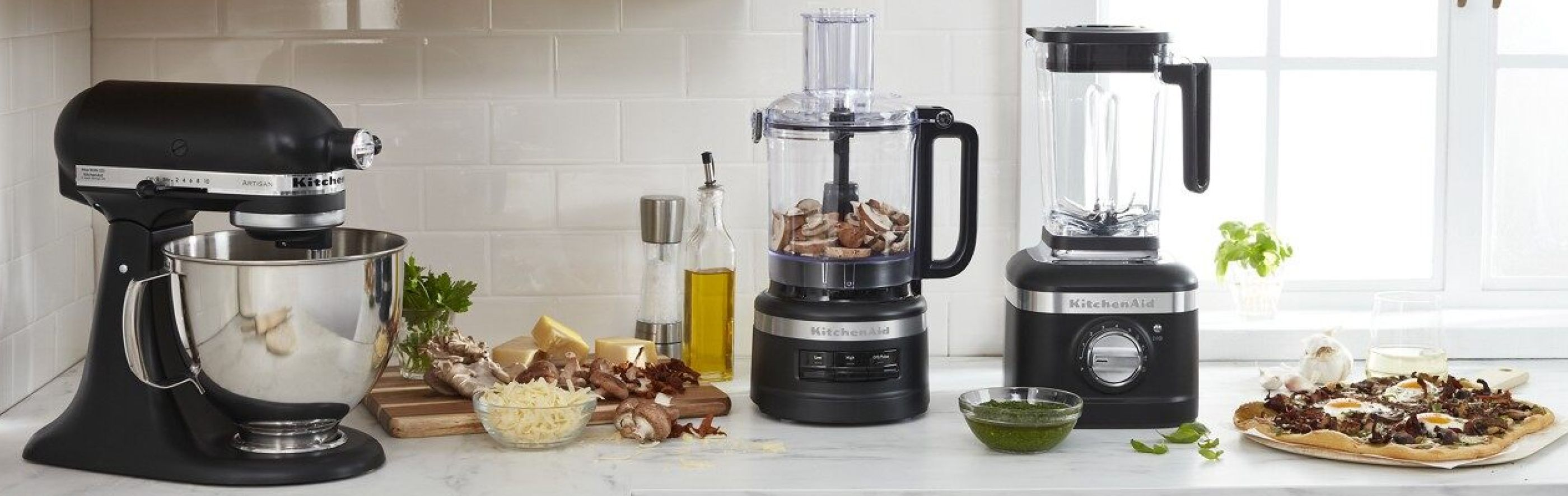 Black KitchenAid® stand mixer, food processor and blender on countertop