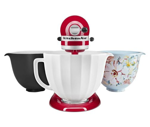 Red stand mixer with three ceramic bowls that are interchangeable