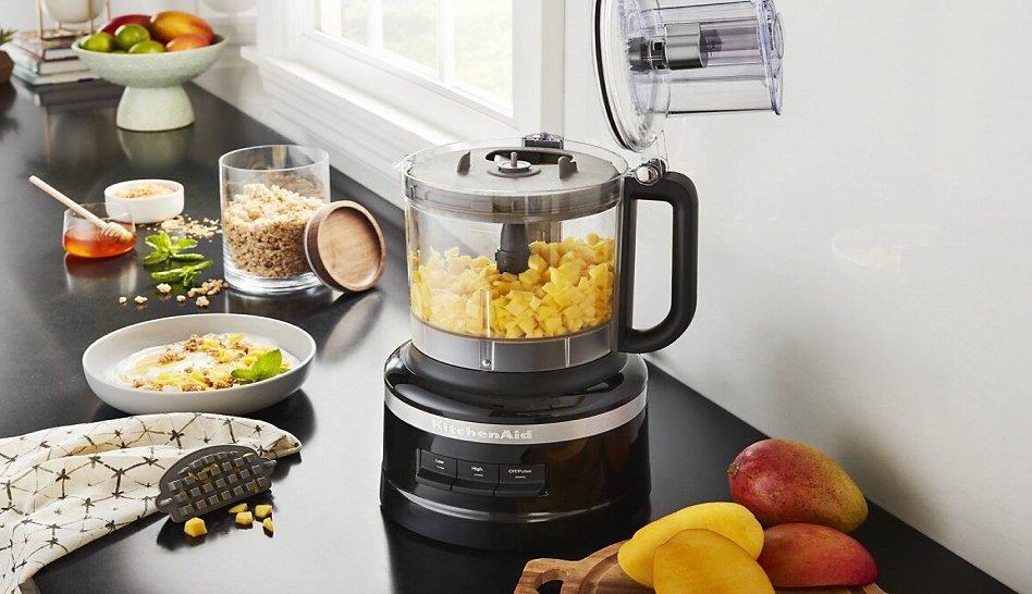 Black KitchenAid® food processor with mango in work bowl