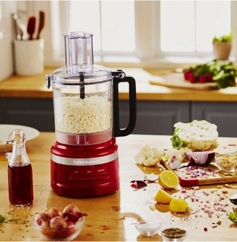 Food processor filled with chopped cauliflower