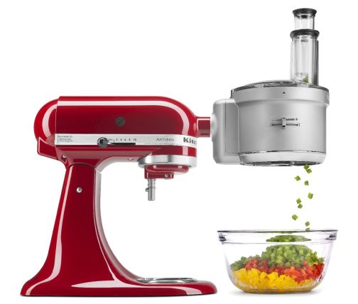 Red stand mixer with food processor attachment dicing peppers in to a bowl