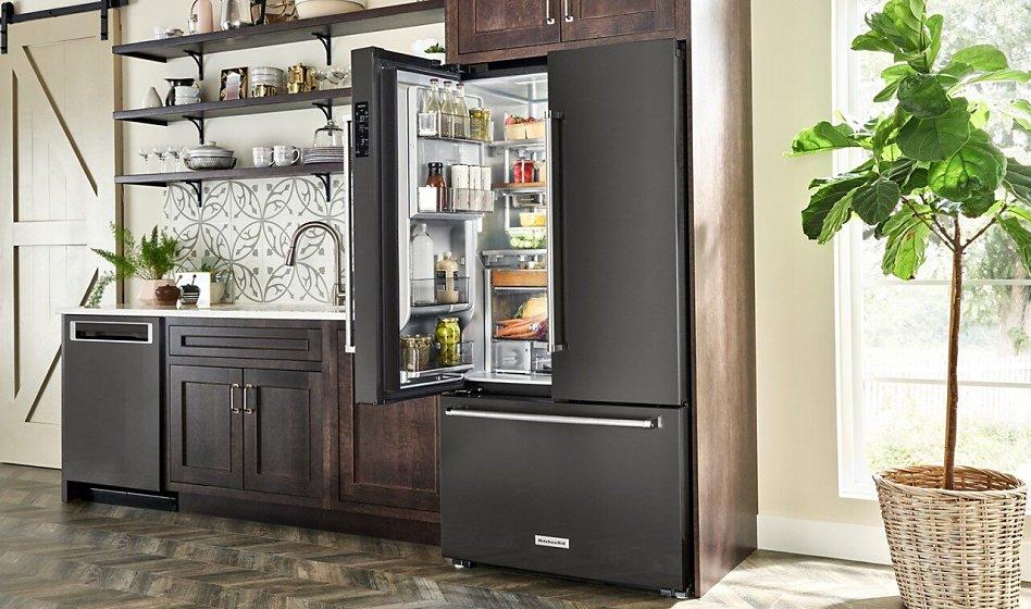 French door refrigerator in kitchen with one door open