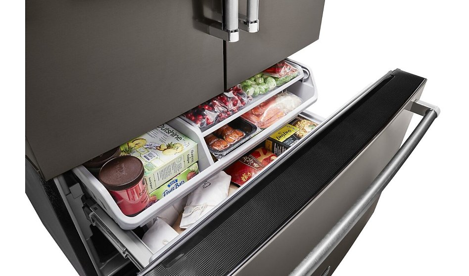 French door refrigerator drawer open with food inside