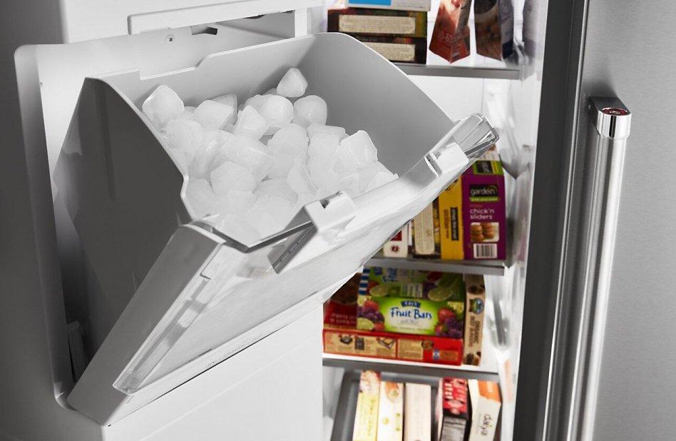 Side by side refrigerator open showing in-door ice storage