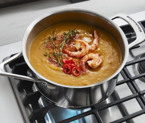 Soup simmering on top of a gas range