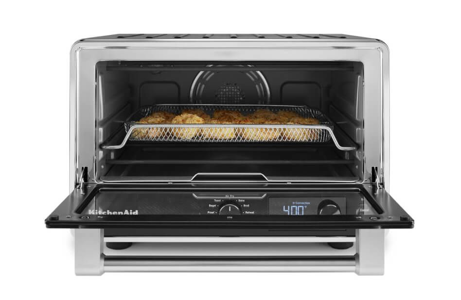 View of an open KitchenAid® countertop oven with food inside