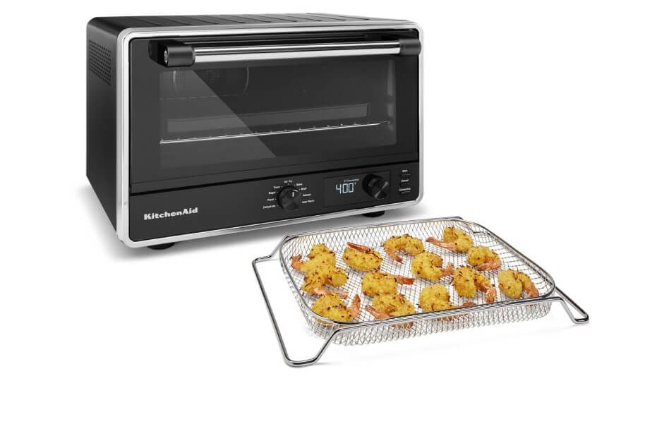 KitchenAid® countertop oven with fried shrimp in air fryer basket