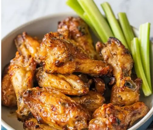 Plate of chicken wings and celery