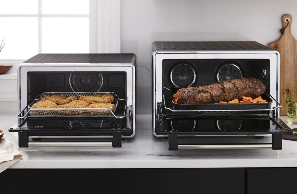 side-to-side countertop ovens loaded with different proteins