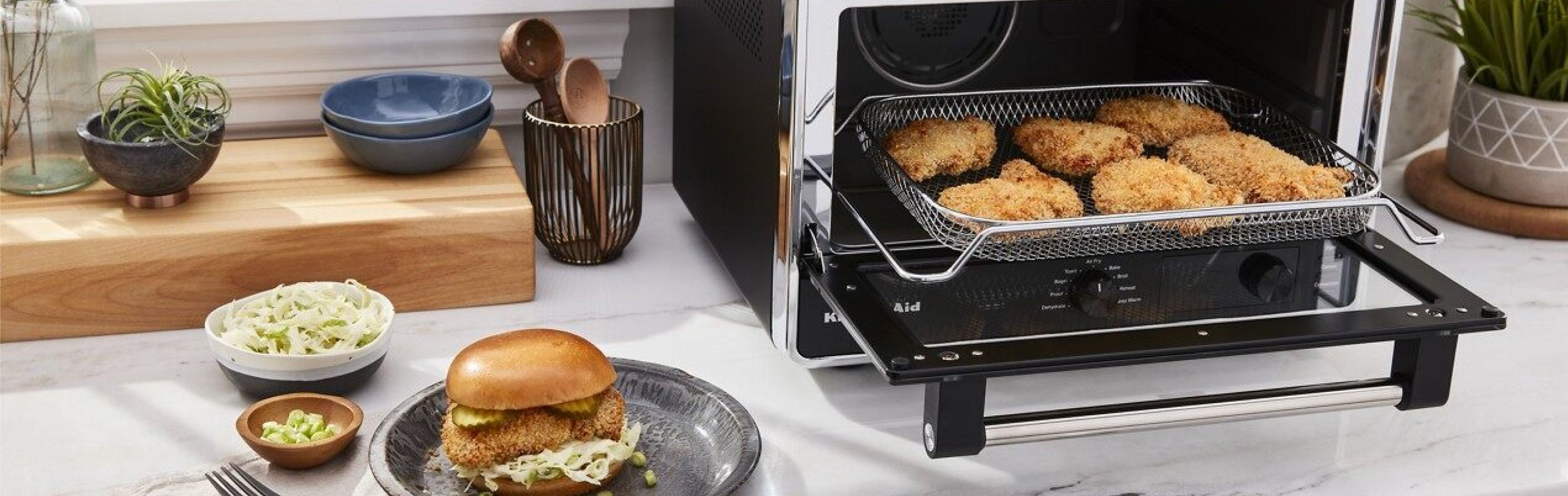Countertop with KitchenAid® countertop oven with various fried foods