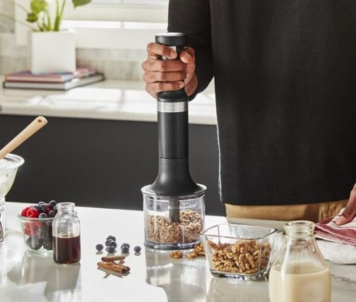 Man chopping nuts with hand blender chopper attachment
