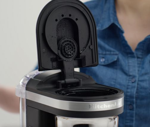 Drip coffee maker with lid open