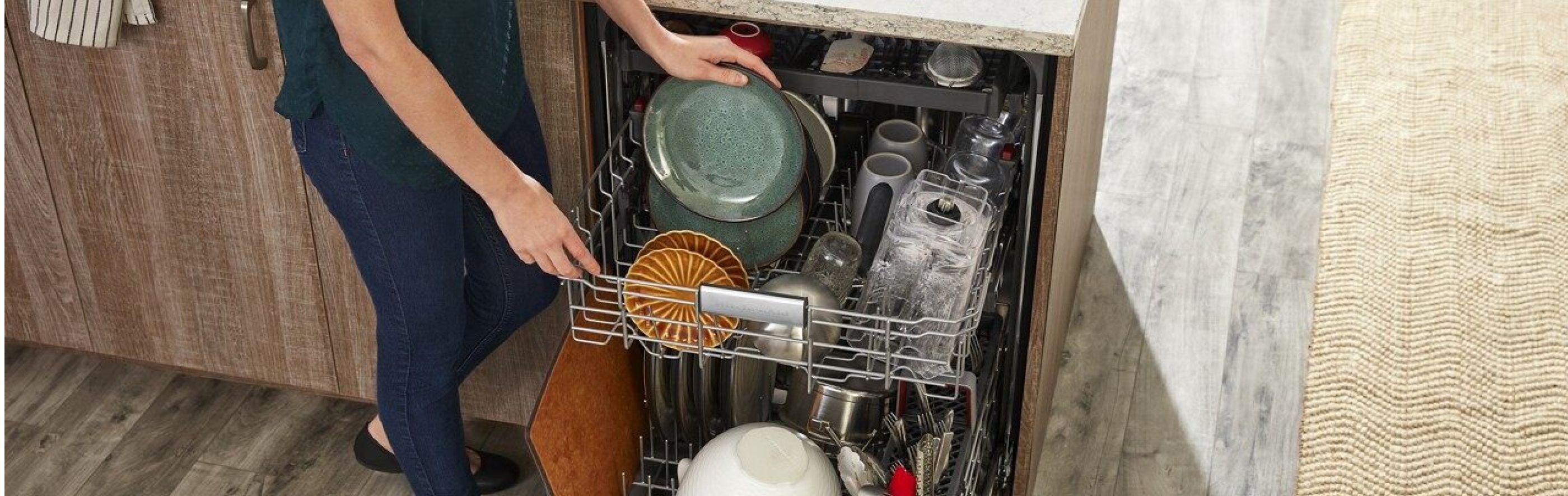 Woman loading dishes into dishwasher
