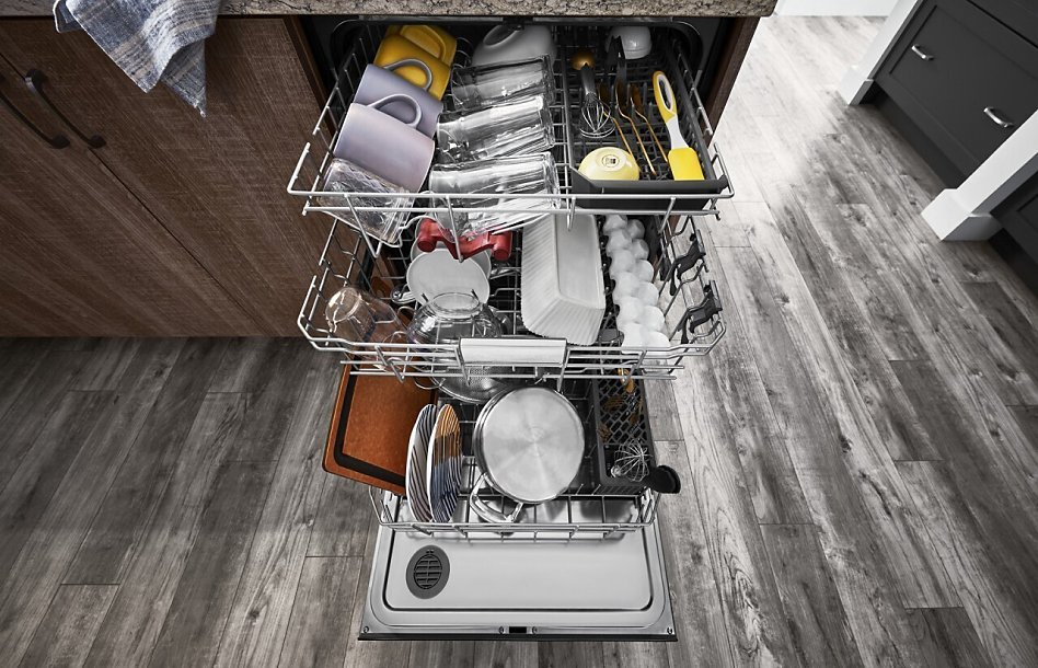 View of a loaded dishwasher with its door open