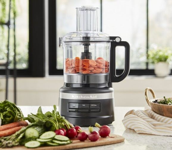 Black KitchenAid® food processor with sliced carrots for baby food