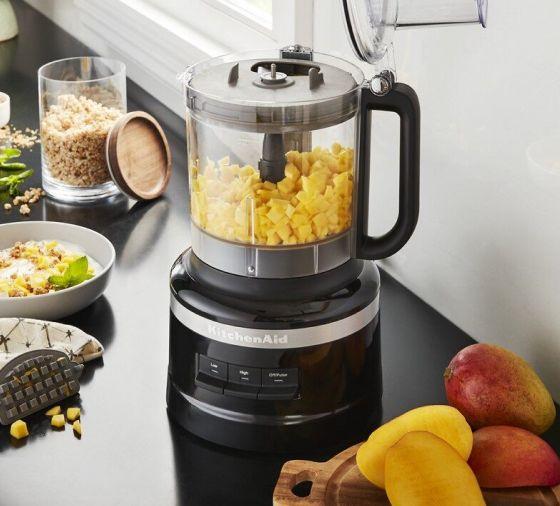 Diced mango in black KitchenAid® food processor for baby food snacks