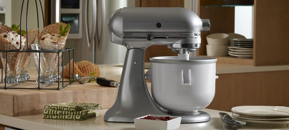 A silver KitchenAid® stand mixer next to waffle cones