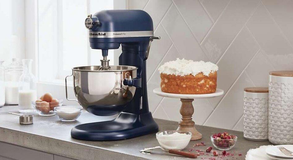 A KitchenAid® bowl-lift stand mixer next to a cake stand