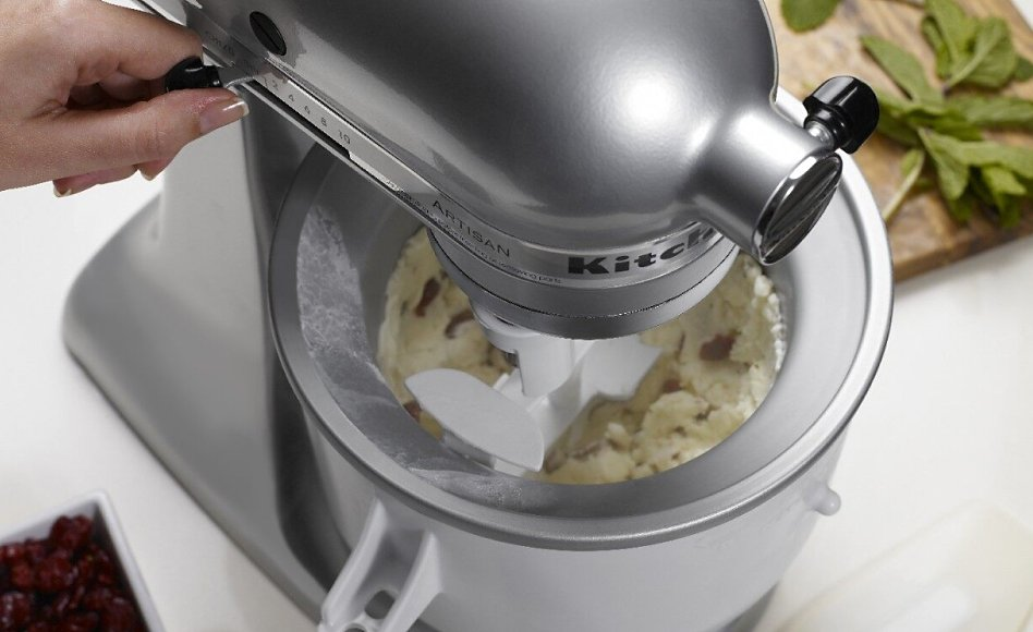 Churning ice cream inside a KitchenAid® Ice Cream Maker attachment bowl
