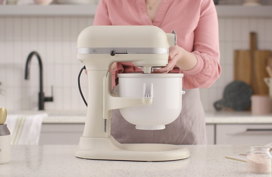 Woman Securing ice cream maker attachment to stand mixer