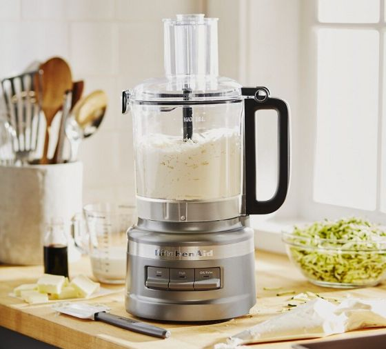 Pie crust ingredients in a food processor on a kitchen counter