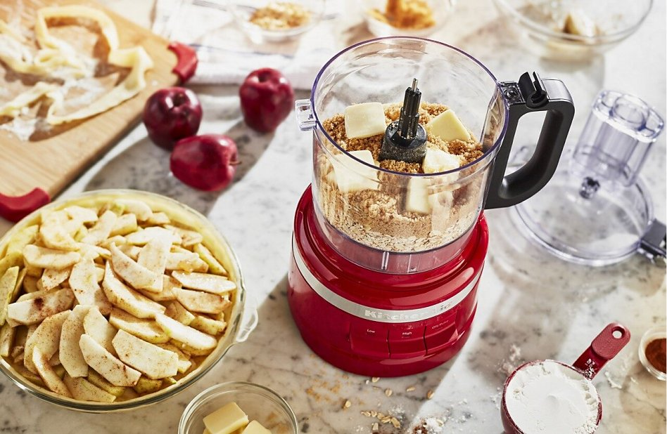 Empire red KitchenAid® food processor with ingredients for apple pie topping