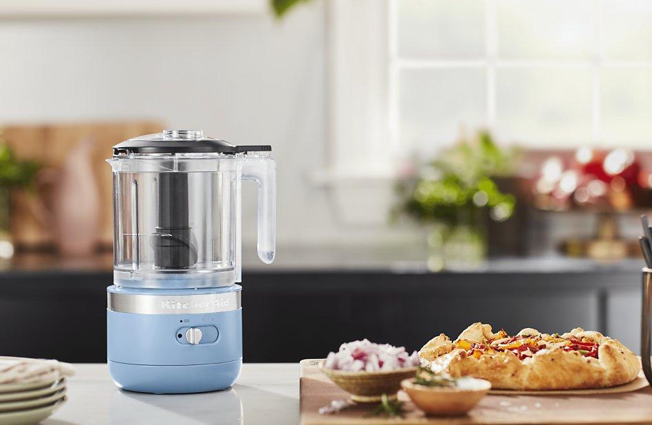 Blue velvet KitchenAid® food chopper next to crostata pie crust on counter