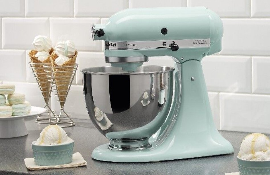 Bowls of ice cream and ice cream cones next to a light blue stand mixer