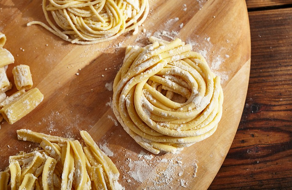 A nest of homemade pasta sprinkled with flour