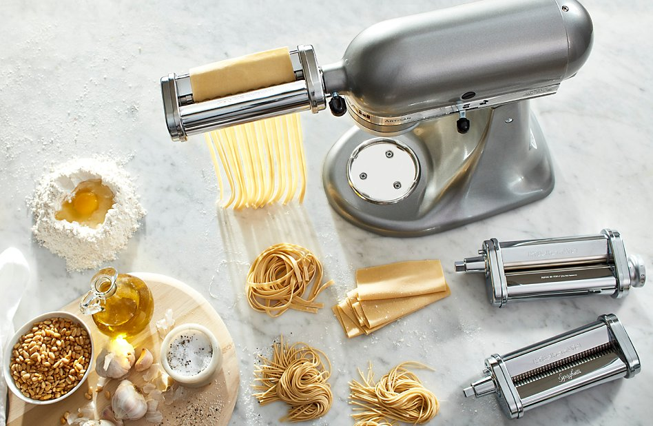 A silver KitchenAid® stand mixer with pasta making attachments