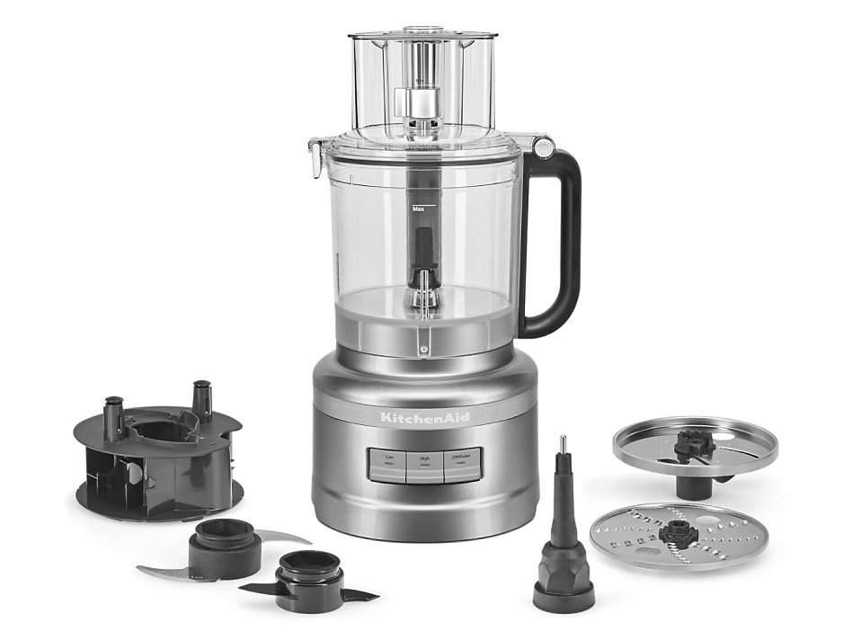 Silver KitchenAid® food processor with different blades and attachments