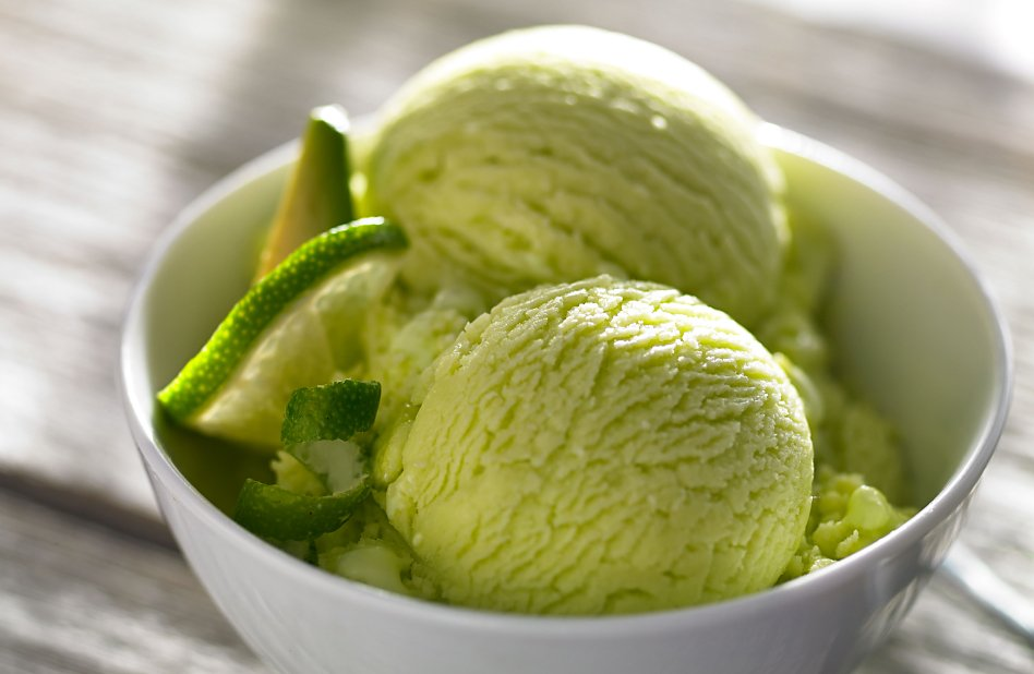 Bowl of homemade green ice cream with lime slices