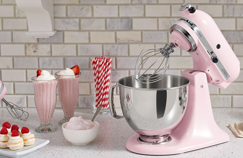 Pink stand mixer surrounded by homemade ice cream recipes