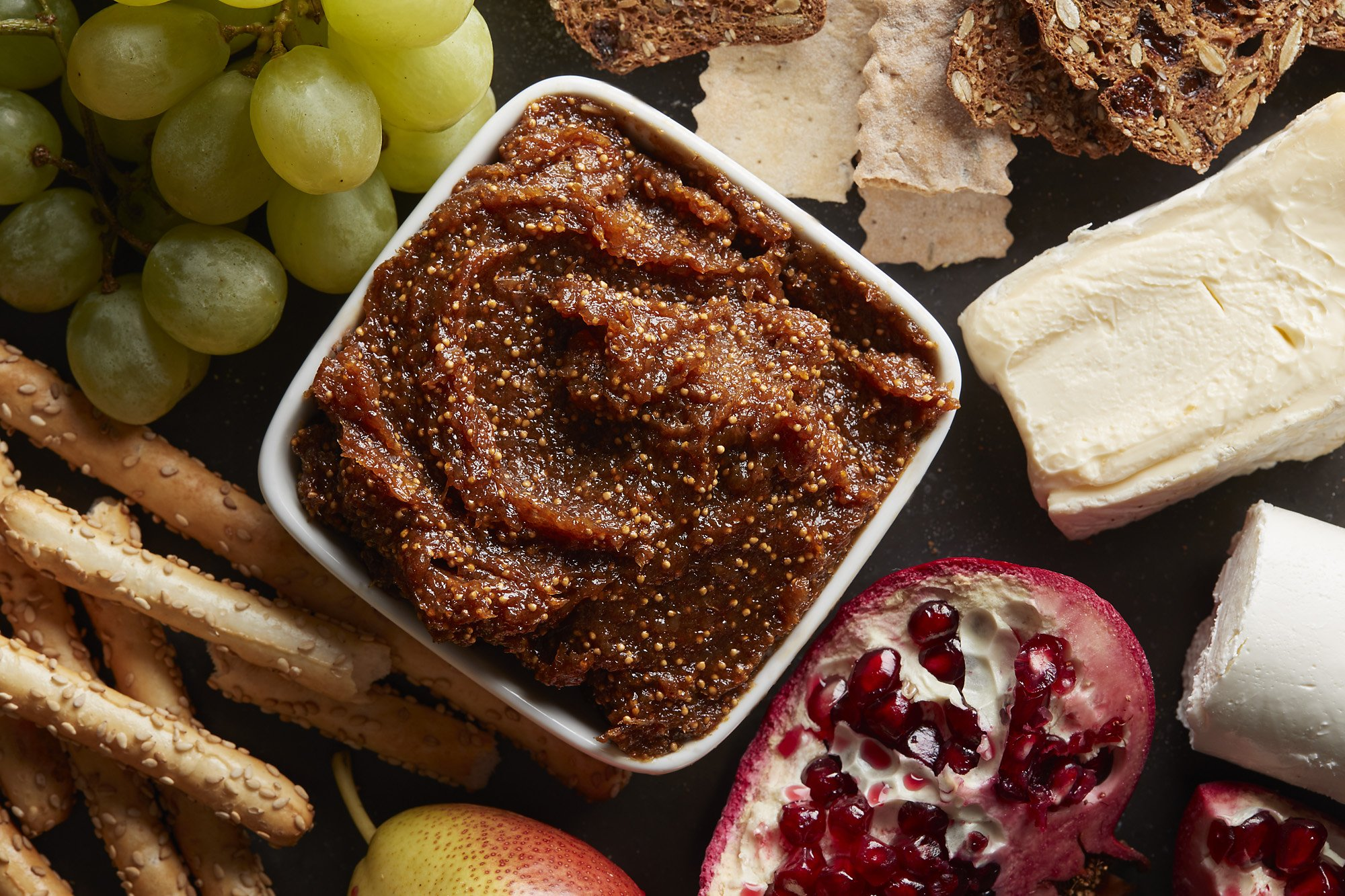 A small bowl of spiced fig jam surrounded by other ingredients