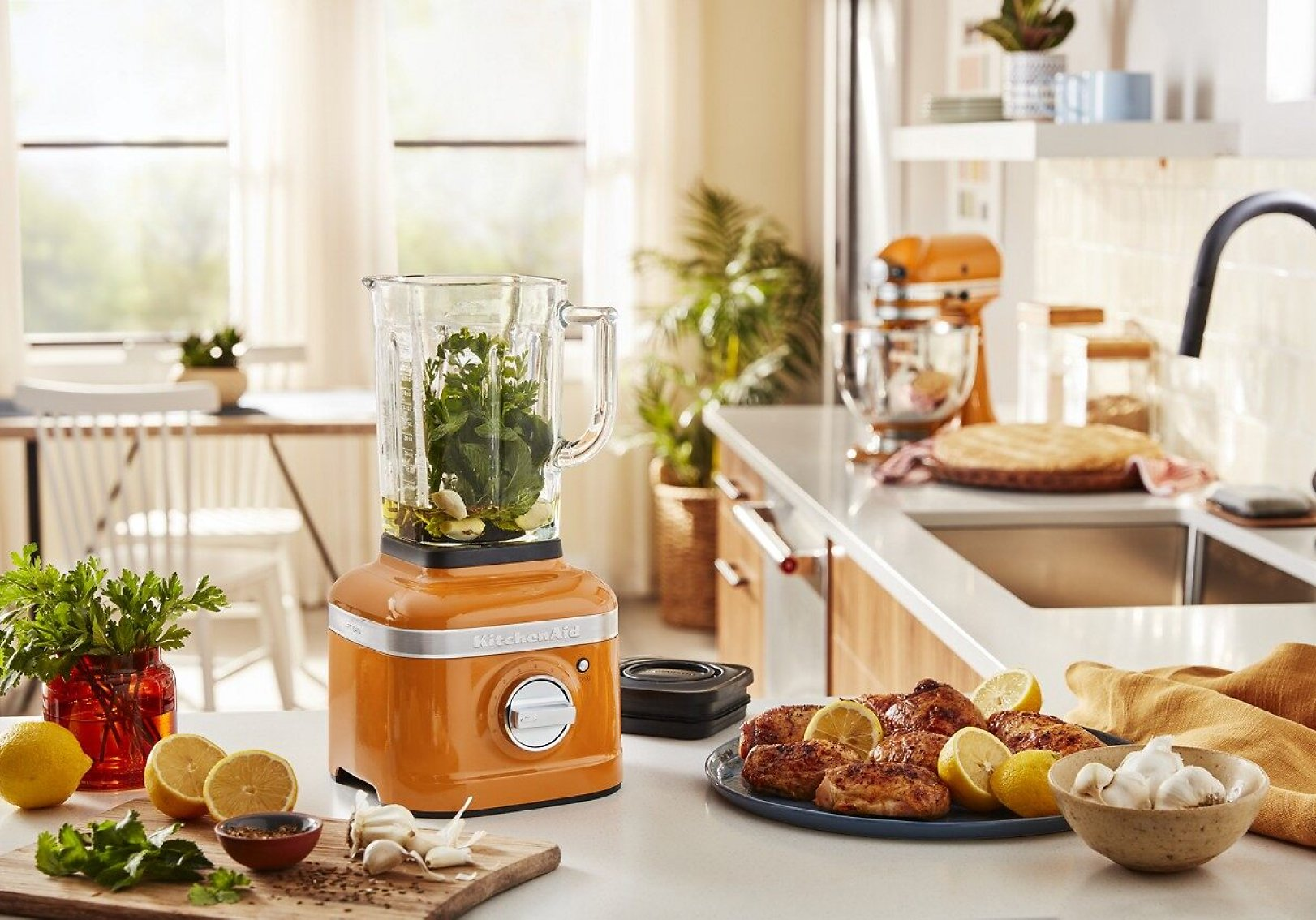 A KitchenAid® blender surrounded by ingredients
