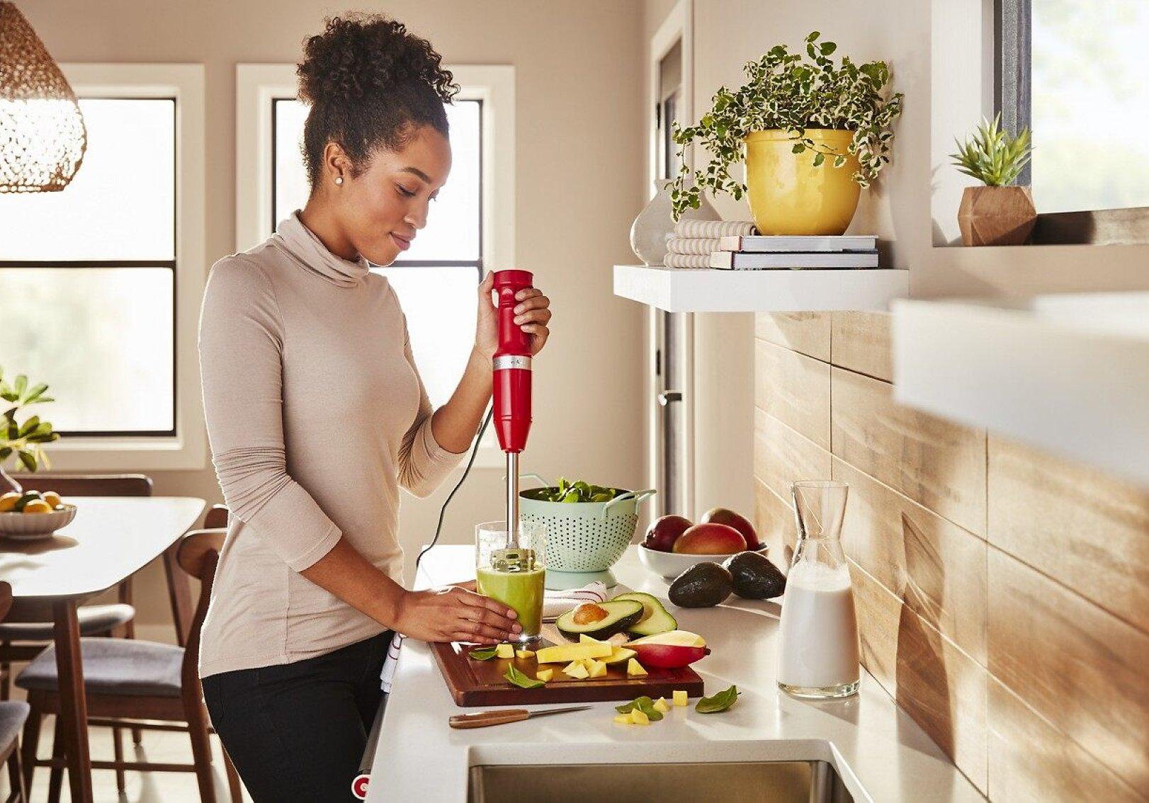 Making an avocado smoothie using a KitchenAid® hand blender.