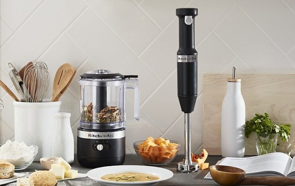 KitchenAid® food chopper and hand blender next to a bowl of soup