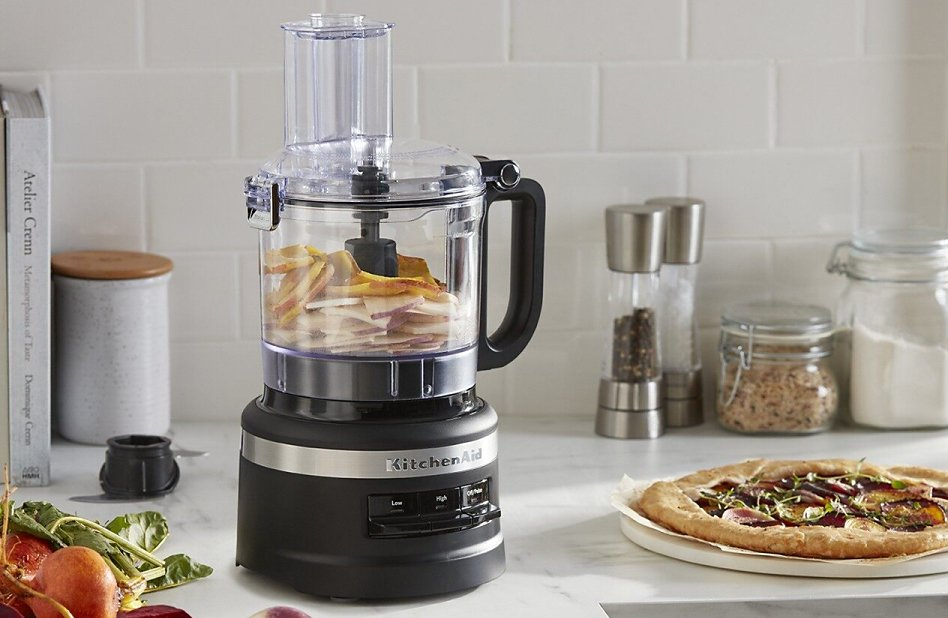 KitchenAid® food chopper next to pizza