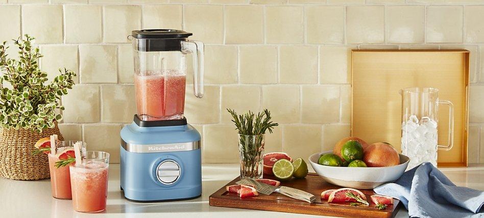 Blue velvet KitchenAid® blender with fruit and glasses of smoothies