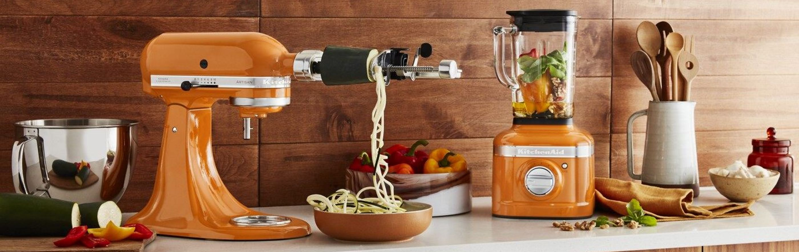 Honey colored KitchenAid® stand mixer and blender on countertop