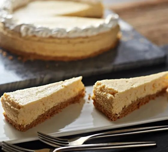 Cheesecake with two slices on platter