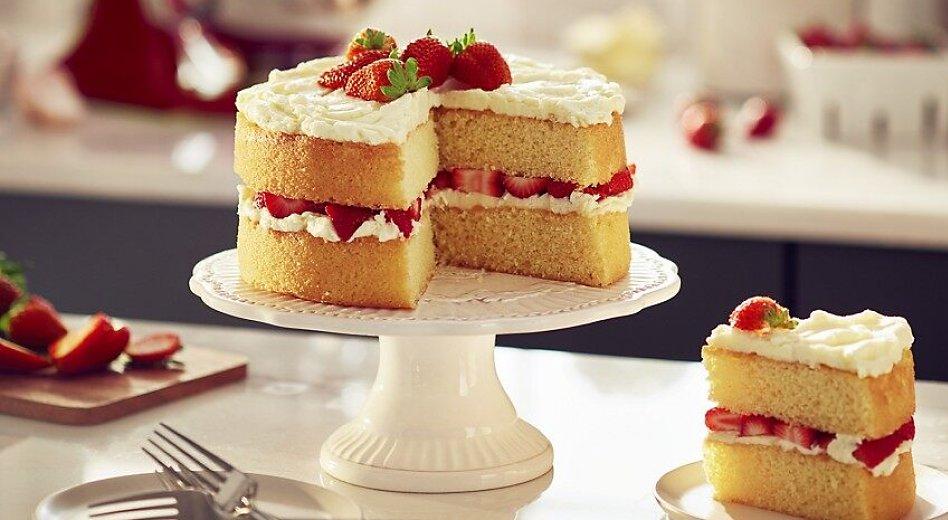 Homemade strawberry shortcake on cake stand