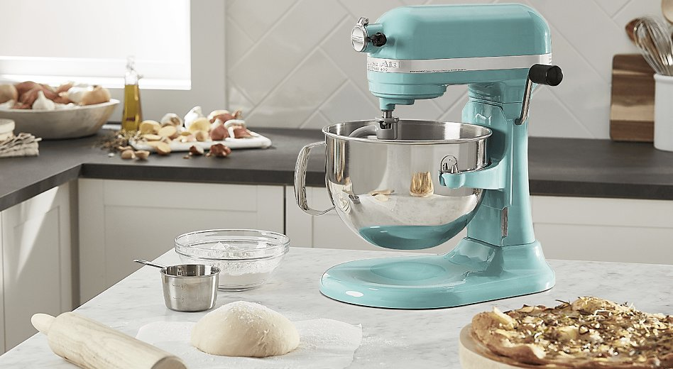 KitchenAid® stand mixer with dough and rolling pin on countertop