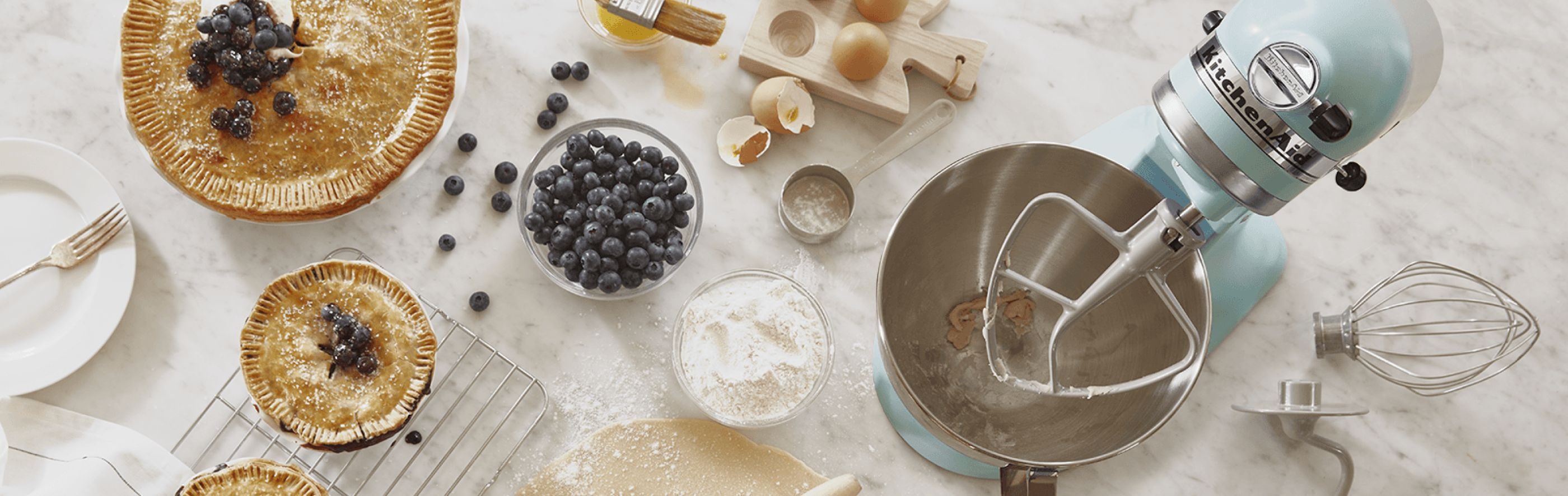 KitchenAid® stand mixer with blueberry pie, tarts, ingredients and homemade pie dough