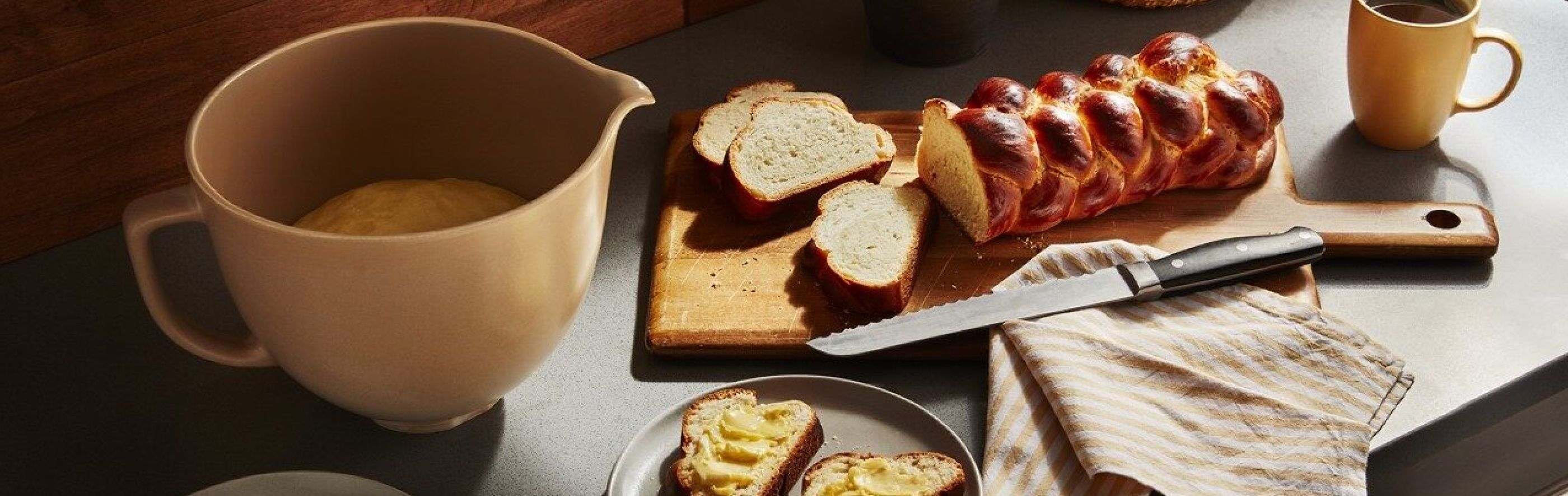 Baked braided bread on counter with stand mixer bowl